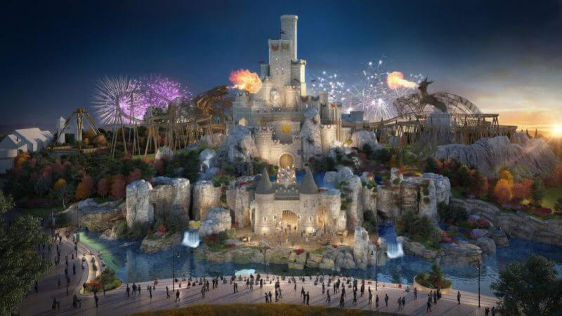 Artist rendering of King Arthur's Castle with roller coaster track behind and fireworks exploding overhead