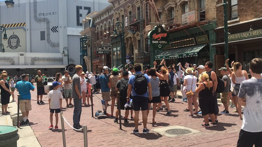 crowds surround the performers of Blue Brothers at Universal Studios