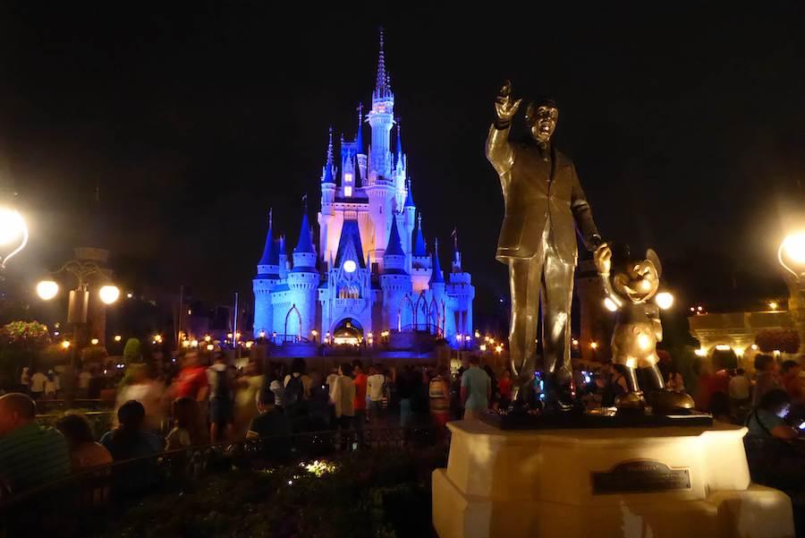 crowds gather to watch the nightly fireworks at Magic Kingdom